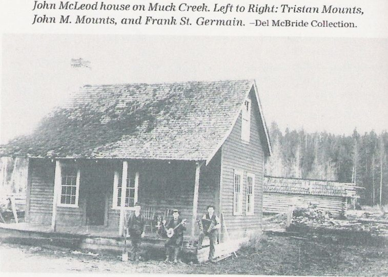 John  McLeod house on Muck Creek located in general area of today's Rocky Ridge School. Lft to Rt: Tristan Mounts, John M. Mounts, and Frank St. Germain. — Del McBride Collection